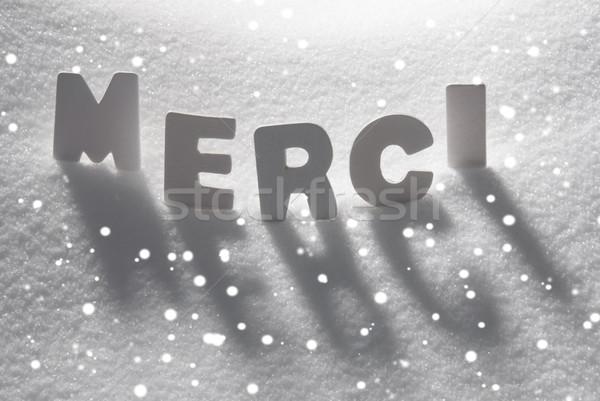White Word Merci Means Thank You On Snow, Snowflakes Stock photo © Nelosa