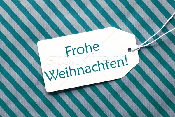 Label On Turquoise Wrapping Paper, Frohe Weihnachten Means Merry Christmas Stock photo © Nelosa
