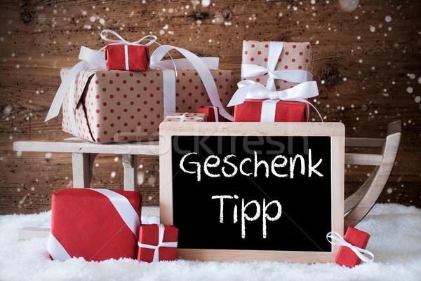 Slee geschenken sneeuw sneeuwvlokken geschenk tip Stockfoto © Nelosa