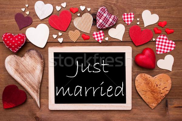 Egy sok piros szívek friss házasok tábla Stock fotó © Nelosa