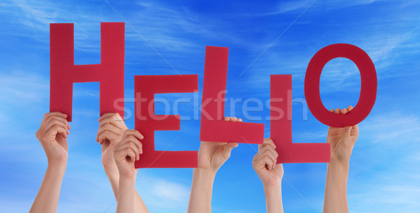 Many People Hands Holding Red Word Hello Blue Sky Stock photo © Nelosa