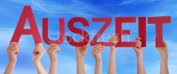 People Holding Straight German Word Auszeit Means Downtime Blue Sky Stock photo © Nelosa