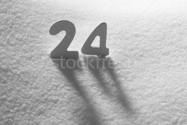 White Number 24 On Snow Stock photo © Nelosa