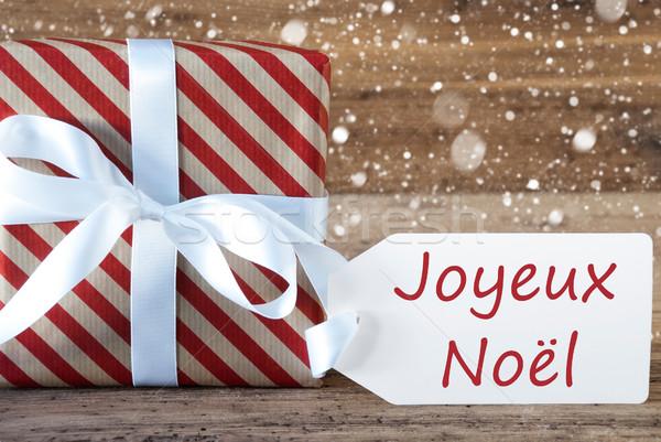 Stock photo: Present With Snowflakes, Text Joyeux Noel Means Merry Christmas