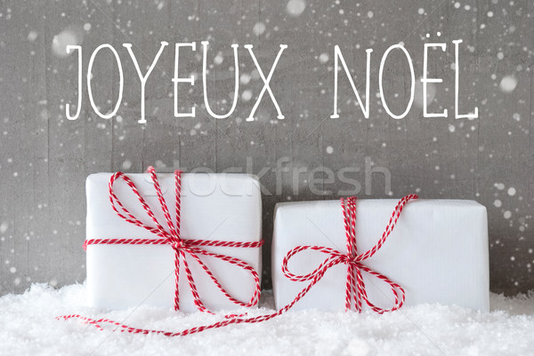 Two Gifts With Snowflakes, Joyeux Noel Means Merry Christmas Stock photo © Nelosa