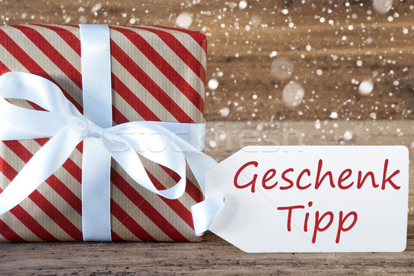 Present With Snowflakes, Text Geschenk Tipp Means Gift Tip Stock photo © Nelosa