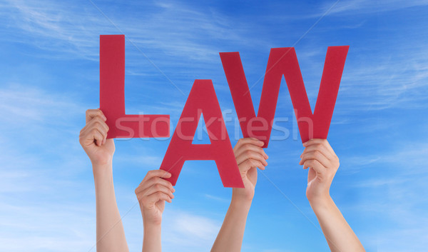 Hands Holding Law in the Sky Stock photo © Nelosa