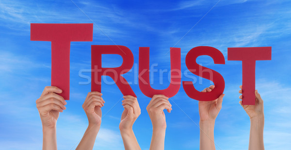 Many People Hands Holding Red Straight Word Trust Blue Sky Stock photo © Nelosa