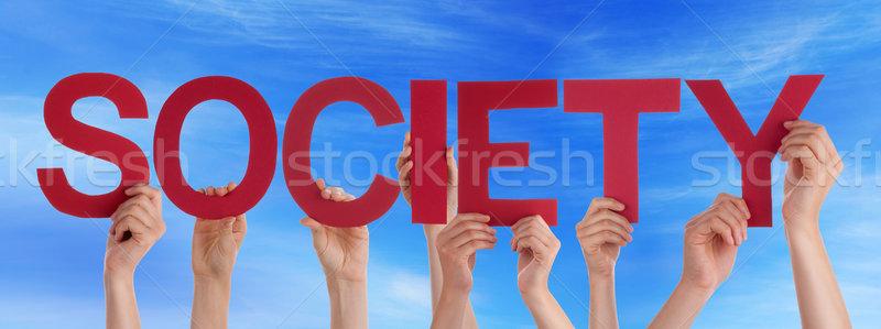 Viele Menschen Hände halten rot gerade Stock foto © Nelosa
