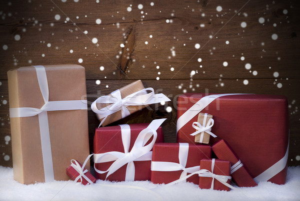 Red Christmas Gifts And Presents With White Ribbon, Snowflakes Stock photo © Nelosa