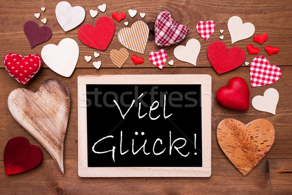 One Chalkbord, Many Red Hearts, Viel Glueck Means Good Luck Stock photo © Nelosa