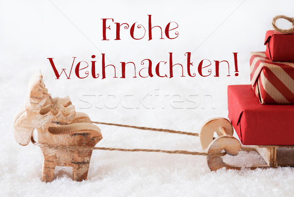 Reindeer With Sled On Snow, Frohe Weihnachten Means Merry Christmas Stock photo © Nelosa