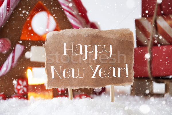 Gingerbread House With Sled, Snowflakes, Text Happy New Year Stock photo © Nelosa