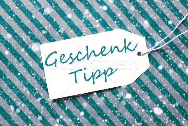 Label, Turquoise Wrapping Paper, Geschenk Tipp Means Gift Tip, Snowflakes Stock photo © Nelosa