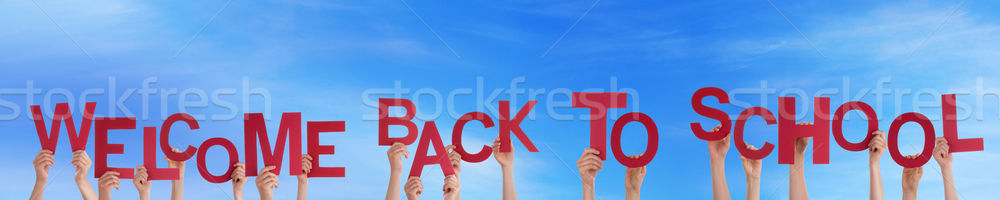 People Holding Welcome Back To School Stock photo © Nelosa