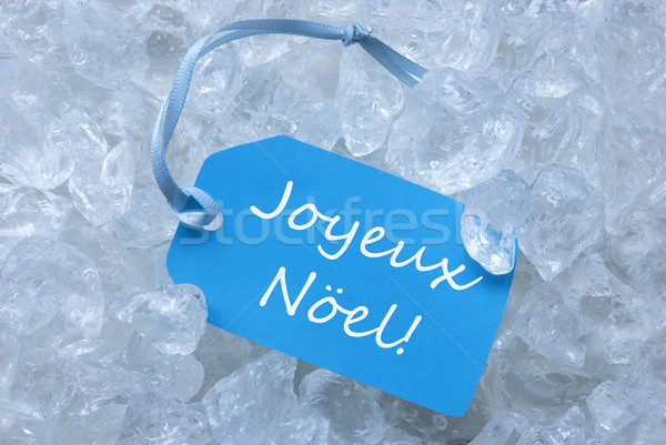 Label On Ice With Joyeux Noel Mean Merry Christmas Stock photo © Nelosa