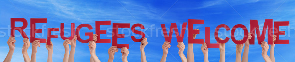 Many People Hands Holding Word Refugees Welcome, Blue Sky Stock photo © Nelosa