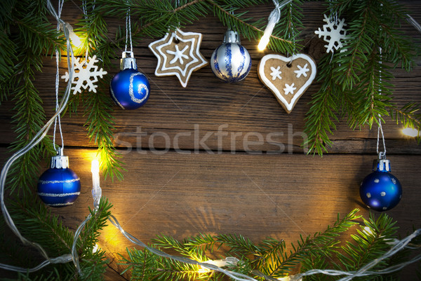 Fairy Lights and Christmas Decoration as Background on Wood Stock photo © Nelosa