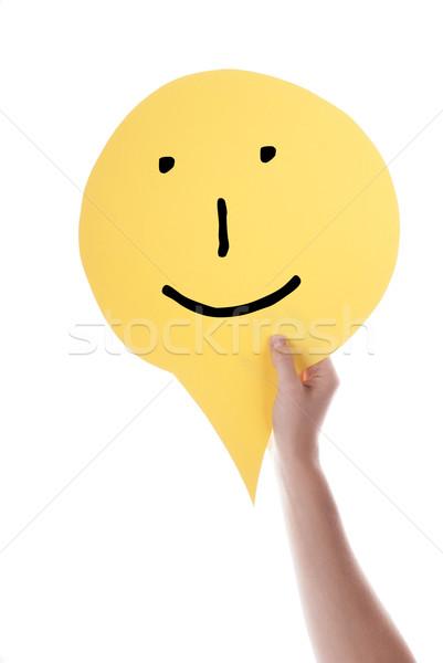 Citromsárga szöveglufi emotikon kéz tart szövegbuborék Stock fotó © Nelosa