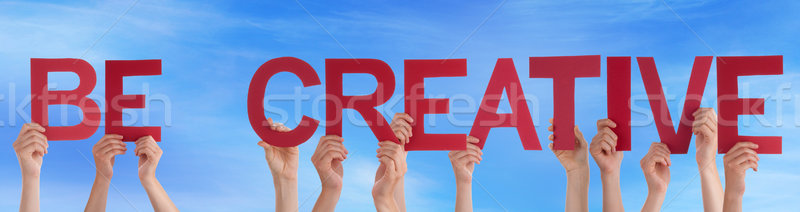 Stock photo: People Hands Holding Red Straight Word Be Creative Blue Sky