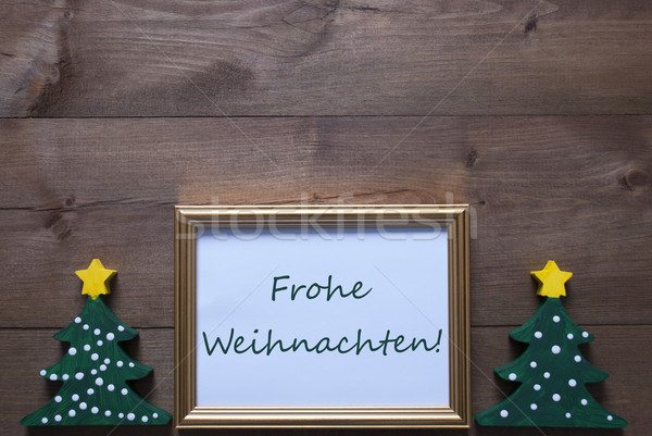 Frame With Trees And Frohe Weihnachten Means Merry Christmas Stock photo © Nelosa