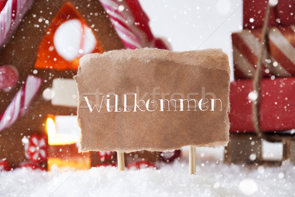 Gingerbread House With Sled, Snowflakes, Willkommen Means Welcom Stock photo © Nelosa