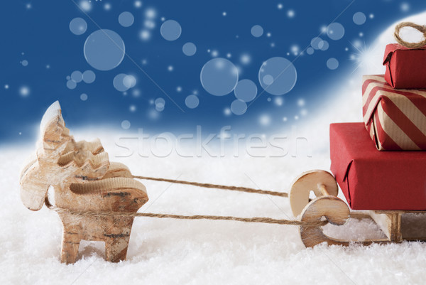 Reindeer With Sled, Copy Space, Blue Bokeh Background Stock photo © Nelosa