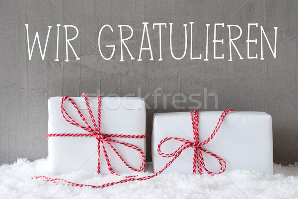 Two Gifts With Snow, Wir Gratulieren Means Congratulations Stock photo © Nelosa