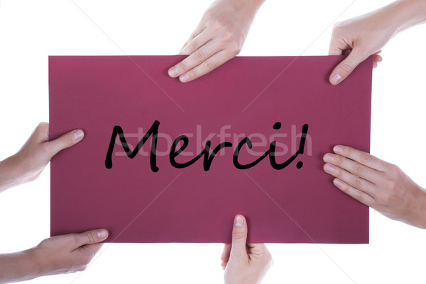 Many Hands Holding A Paper With Merci Stock photo © Nelosa