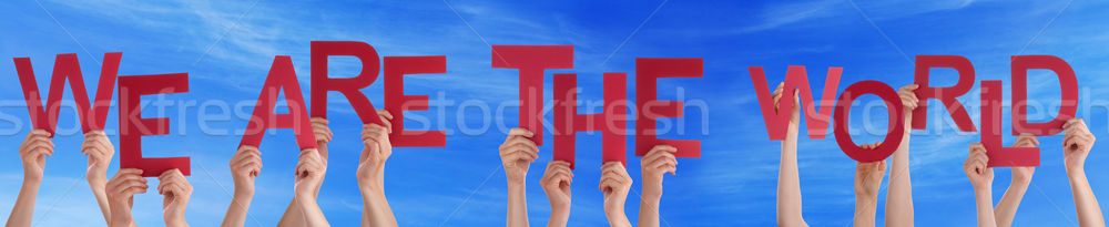 Hands Holding Red Word We Are The World Blue Sky Stock photo © Nelosa