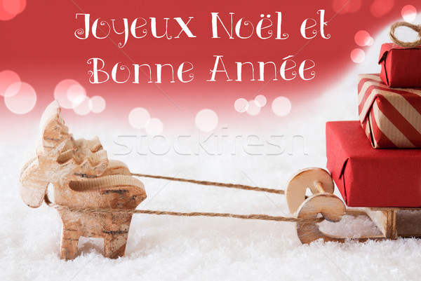 Reindeer With Sled, Red Background, Bonne Annee Means New Year Stock photo © Nelosa