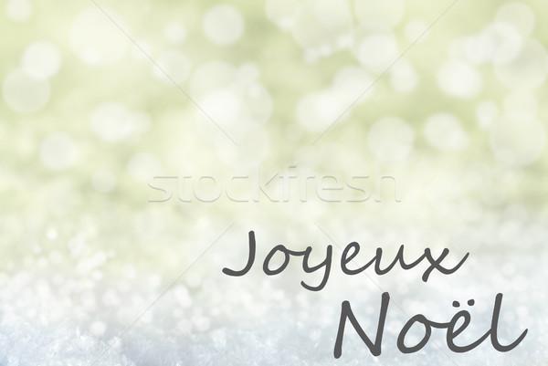 Golden Bokeh Background, Snow, Joyeux Noel Means Merry Christmas Stock photo © Nelosa