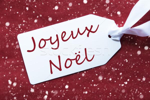 Label On Red Background, Snowflakes, Joyeux Noel Means Merry Christmas Stock photo © Nelosa