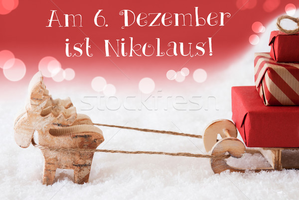Reindeer With Sled, Red Background, Nikolaus Means Nicholas Day Stock photo © Nelosa