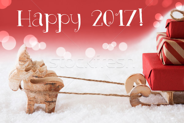 Reindeer With Sled, Red Background, Text Happy 2017 Stock photo © Nelosa