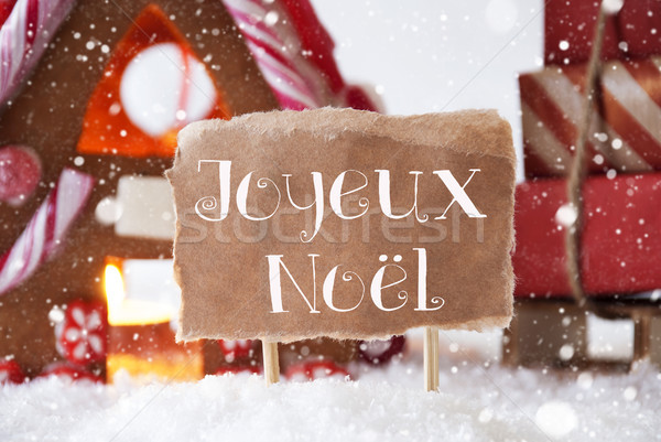 Gingerbread House With Sled, Snowflakes, Joyeux Noel Means Merry Christmas Stock photo © Nelosa