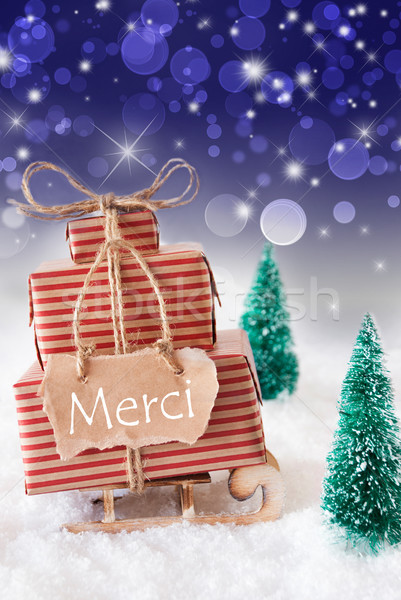 Vertical Christmas Sleigh, Blue Background, Merci Means Thank You Stock photo © Nelosa