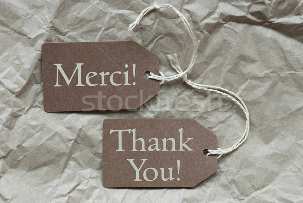 Two Beige Labels Merci Means Thank You  Stock photo © Nelosa