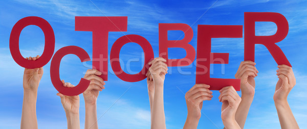 Stock photo: People Hands Holding Red Word October Blue Sky