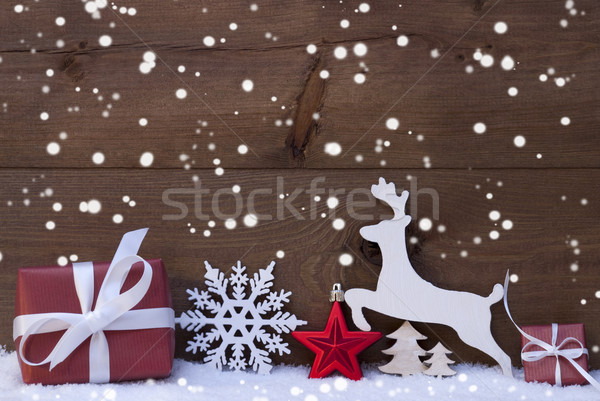 Red Christmas Decoration, Snow, Snowflakes, Reindeer And Gift Stock photo © Nelosa