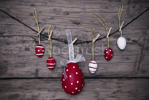 Many Red And White Easter Eggs And One Big Egg Hanging On Line Frame Stock photo © Nelosa