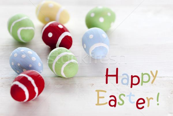 Sok színes húsvéti tojások angol szöveg kellemes húsvétot Stock fotó © Nelosa