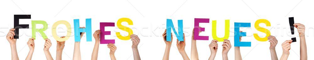 People Holding Frohes Neues Stock photo © Nelosa