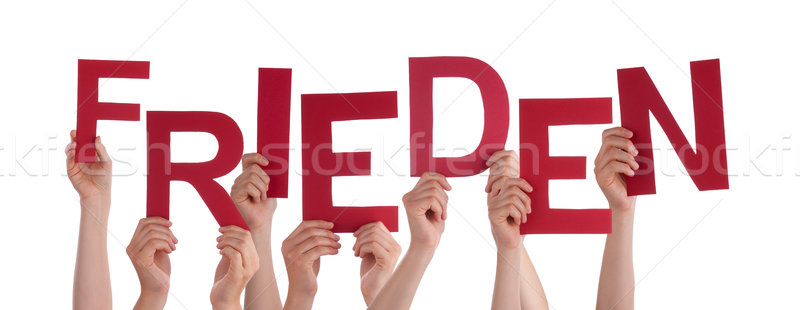 People Holding German Word Frieden Means Peace Stock photo © Nelosa