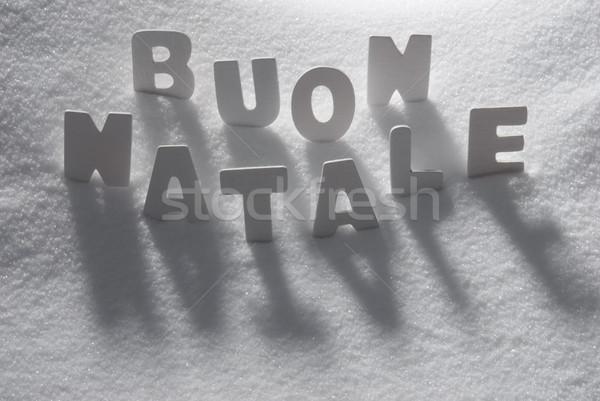 White Word Buon Natale Mean Merry Christmas On Snow Stock photo © Nelosa