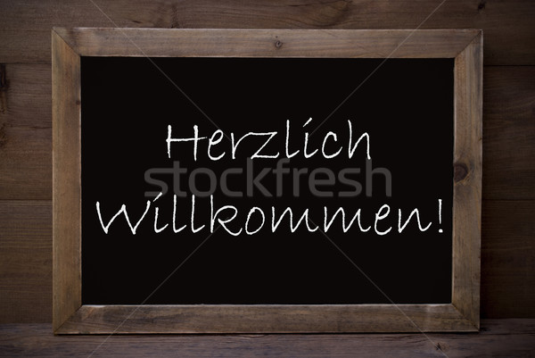 Chalkboard With Herzlich Willkommen Means Welcome Stock photo © Nelosa