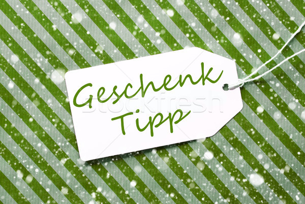 Label, Green Wrapping Paper, Geschenk Tipp Means Gift Tip, Snowflakes Stock photo © Nelosa