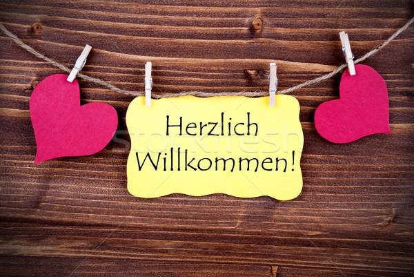 Yellow Label with Herzlich Willkommen Stock photo © Nelosa