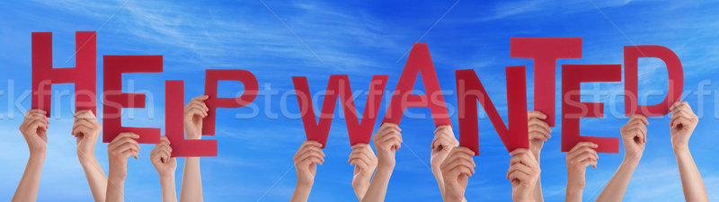 People Hands Holding Red Word Help Wanted Blue Sky Stock photo © Nelosa