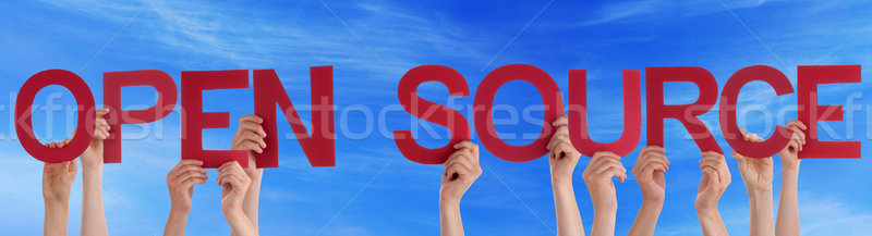 People Hands Holding Red Straight Word Open Source Blue Sky Stock photo © Nelosa